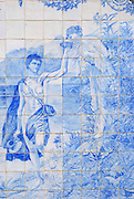 ESTOI, PORTUGAL - JULY 20, 2006: Old azulejo tiles at the garden of the Estoi palace, Algarve, Portugal. Estoi palace built in the late 19th century is the best example of Rococo architecture in Algarve region, Portugal.
