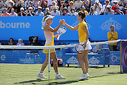 Caroline Wozniacki of Denmark shakes the hand of Andrea Petkovic of Germany after her win at the Aegon International Quarter Final match between Andrea Petkovic and Caroline Wozniacki at Devonshire Park, Eastbourne, United Kingdom on 25 June 2015. Photo by Phil Duncan.
