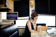 GOP Presidential candidate Rep. Michele Bachmann listens to a conference call with House Speaker John Boehner while on her campaign bus in Muscatine, Iowa, July 24, 2011.