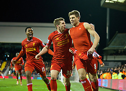 LONDON, ENGLAND - Wednesday, February 12, 2014: Liverpool's captain Steven Gerrard celebrates scoring the winning third goal against Fulham from the penalty spot with team-mates Jon Flanagan and Daniel Sturridge during the Premiership match at Craven Cottage. (Pic by David Rawcliffe/Propaganda)