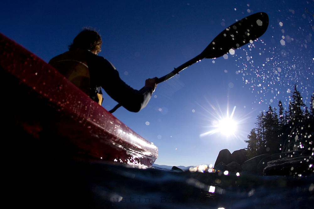 Young man kayaking near DL Bliss State Park on Lake Tahoe, CA.