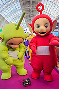 The Teletubies celebrate their 20th anniversary by siezing a remote control car - The London Toy Fair opens at Olympia exhibition centre. Organised by the British Toy and Hobby Association it is the only dedicated toy, game and hobby trade exhibition in the UK. It runs for three days, with more than 240 exhibiting companies ranging from the large internationals to the new start up companies.