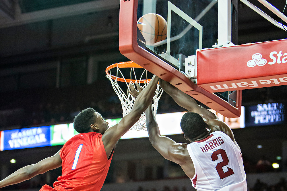 FAYETTEVILLE, AR - NOVEMBER 18:  Ryan Manuel #1 of the SMU Mustangs goes up to block a shot by Alandise Harris #2 of the Arkansas Razorbacks at Bud Walton Arena on November 18, 2013 in Fayetteville, Arkansas.  The Razorbacks defeated the Mustangs 89-78.  (Photo by Wesley Hitt/Getty Images) *** Local Caption *** Ryan Manuel; Alandise Harris