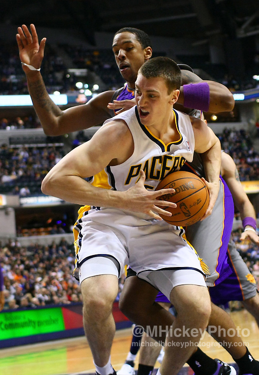 Feb. 27, 2011; Indianapolis, IN, USA; Indiana Pacers forward Tyler Hansbrough (50) drives the baseline as Phoenix Suns center Channing Frye (8) defends from behind at Conseco Fieldhouse. Mandatory credit: Michael Hickey-US PRESSWIRE