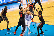 OKLAHOMA CITY, OK - APRIL 21: Steven Adams #12 of the Oklahoma City Thunder tries to get a shot off against Maurice Harkless #4 and Enes Kanter #00 of the Portland Trail Blazers during Round One Game Three of the 2019 NBA Playoffs on April 21, 2019 at Chesapeake Energy Arena in Oklahoma City, Oklahoma  NOTE TO USER: User expressly acknowledges and agrees that, by downloading and or using this photograph, User is consenting to the terms and conditions of the Getty Images License Agreement.  The Trail Blazers defeated the Thunder 111-98.  (Photo by Wesley Hitt/Getty Images) *** Local Caption *** Steven Adams; Enes Kanter; Maurice Harkless