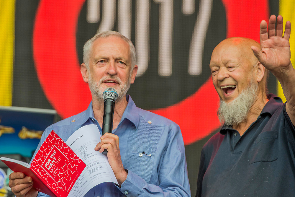 Jeremy gives Michael his red book - Jeremy Corbyn is introduced to an enthusiastic crowd at the Pyramid Stage by Michael Eavis - The 2017 Glastonbury Festival, Worthy Farm. Glastonbury, 24 June 2017