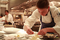 preparing foods in the kitchen of the restaurant Per Se, in NY, the restauarnt of Thomas Keller....Photograph by Owen Franken ..