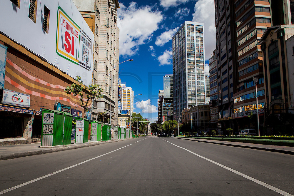 The middle of the 16th Avenue in central La Paz. On a normal day it would be impossible to stand here since this avenue is one of the main arteries of La Paz.  During elections period in  Bolivia, the country faces several restrictions, like no alcohol for sale 48 hours before and 12 after the election; no public gatherings, shows of any kind until the political parties made their speeches on the election night; its completely forbidden the circulation of any vehicles, private or governmental except with the permit from the Electoral Tribunal, which means it would be basically no cars, buses or anything circulating in the city; no long distance buses, the terminal will be close from Saturday until Monday and even flights will not be allowed except the ones leaving the country or the international ones doing stop-over. It is a completely shut down of the country.
