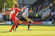 York City forward Emile Sinclair and Notts County defender Haydn Hollis battle for the ball during the Sky Bet League 2 match between Notts County and York City at Meadow Lane, Nottingham, England on 26 September 2015. Photo by Simon Davies.