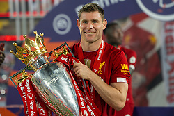 LIVERPOOL, ENGLAND - Wednesday, July 22, 2020: Liverpool's James Milner celebrates with the Premier League trophy as the Reds are crowned Champions after the FA Premier League match between Liverpool FC and Chelsea FC at Anfield. The game was played behind closed doors due to the UK government's social distancing laws during the Coronavirus COVID-19 Pandemic. (Pic by David Rawcliffe/Propaganda)