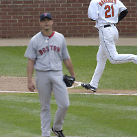 09 September 2007:  Baltimore Orioles right fielder Nick Markakis (21) rounds the bases after hitting a solo home run in the 6th inning against Boston Red Sox pitcher Josh Beckett (19).  The Red Sox defeated the Orioles 3-2 at Camden Yards in Baltimore, MD.  ****For Editorial Use Only****