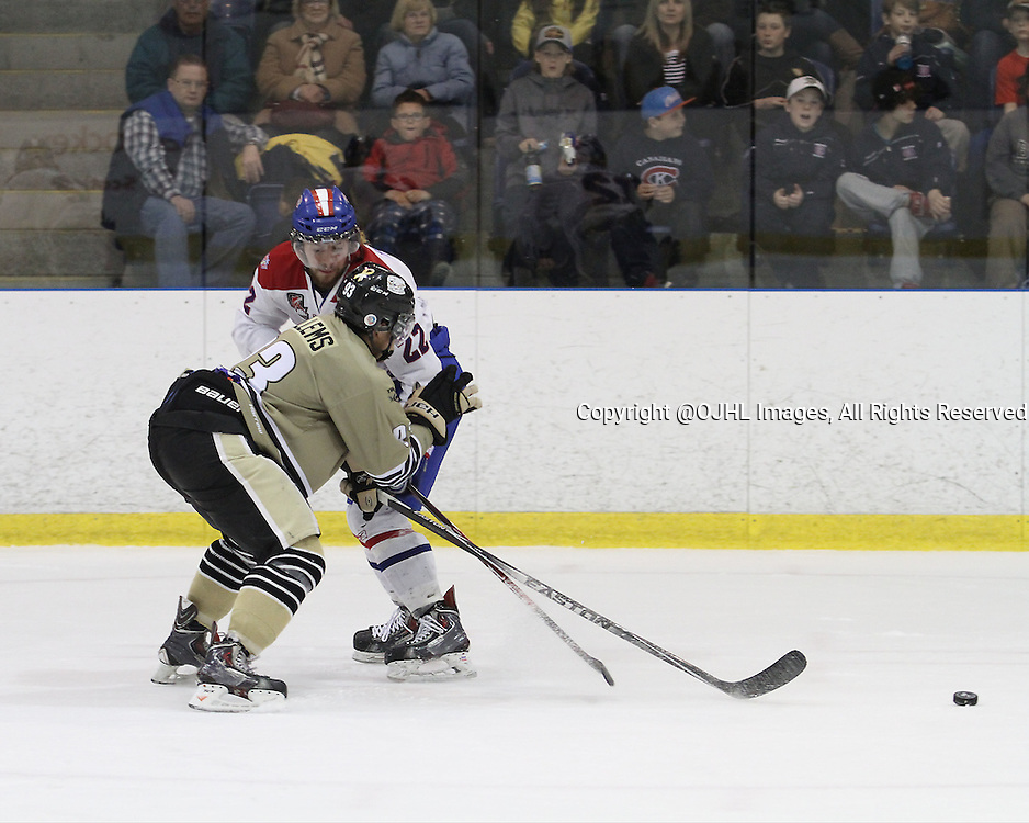KINGSTON, ON - Apr 5, 2015 : Ontario Junior Hockey League game action between the Trenton Golden Hawks and the Kingston Voyageurs. Game 6 of the best of seven semi-final series. Alex Tonge #22 of the Kingston Voyageurs &amp; Braden Hellems #93 of the Trenton Golden Hawks during second period game action.<br /> (Photo by Robert John Boucher / OJHL Images)