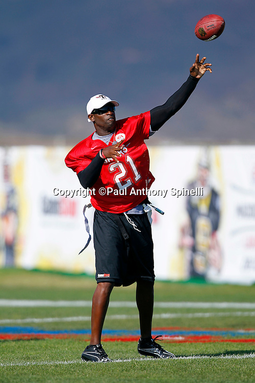 Former Dallas Cowboys cornerback Deion Sanders (21) of the Gamers team throws a pass while playing flag football in the EA Sports Madden NFL 11 Launch celebrity and NFL player flag football game held at Malibu Bluffs State Park on July 22, 2010 in Malibu, California. (©Paul Anthony Spinelli)