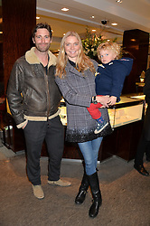 JODIE KIDD holding her son INDIO VIANINI and DAVID BLAKELEY at a VIP evening hosted by Joely Richardson at the Tiffany & Co Christmas Shop, Tiffany & Co Old Bond Street, London on 24th November 2013.