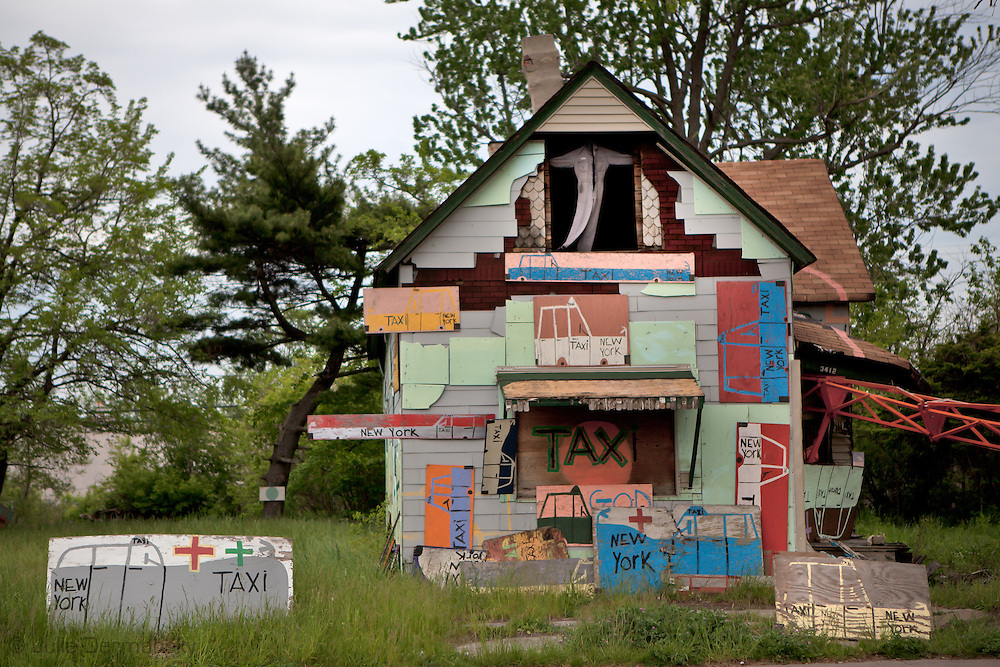 The Taxi house, part of the Heidelberg Project, a folk art instaltion taking up over two city blocks in Detroit started by artist Tyree Guyton. This building was destroyed by arson in 2013. As of March 2014, only two of the structures remain in the project, the rest have been lost to fire.