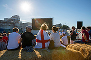 Football fans watch the England V Belgium game on the big screen at the Harbrour Arm.