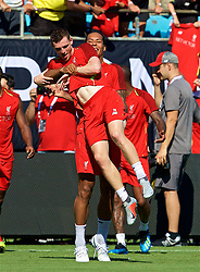 CHARLOTTE, USA - Saturday, July 21, 2018: Liverpool's Andy Robertson is picked up by Virgil van Dijk during a training session at the Bank of America Stadium ahead of a preseason International Champions Cup match between Borussia Dortmund and Liverpool FC. (Pic by David Rawcliffe/Propaganda)