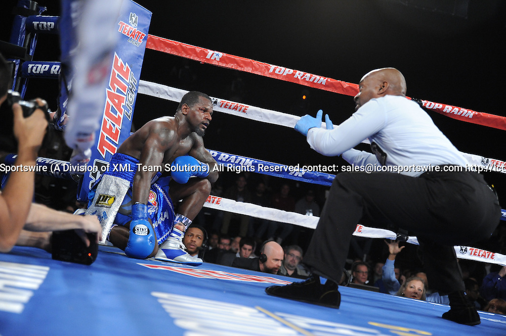 February 27, 2016: Henry Lundy receiving a standing 10 count as Terrance Crawford retains the WBO Lightweight title by TKO of Round 5, while in action against Henry Lundy during a boxing match at the Theater at Madison Square Garden in New York, New York
