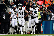 Philadelphia Eagles Carson Wentz QB (11) and Philadelphia Eagles Fletcher Cox DT (91) lead the team on to the field during the International Series match between Jacksonville Jaguars and Philadelphia Eagles at Wembley Stadium, London, England on 28 October 2018.
