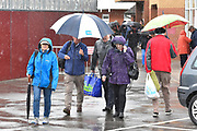 Rain Stops Play - Spectators heading for the exit with umbrellas up as the heavy rain continues to fall during the Specsavers County Champ Div 1 match between Somerset County Cricket Club and Essex County Cricket Club at the Cooper Associates County Ground, Taunton, United Kingdom on 23 September 2019.