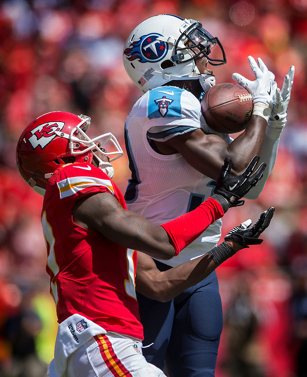 Tennessee Titans cornerback Jason McCourty (30) intercepted a pass intended for Kansas City Chiefs wide receiver Donnie Avery (17) in the third quarter at Arrowhead Stadium in Kansas City, Mo. on September 7, 2014. The Titans won 26-10.