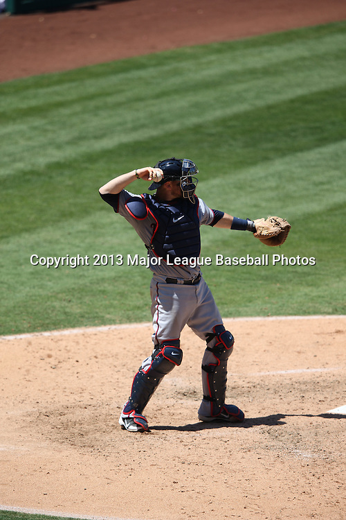 ANAHEIM, CA - JULY 24:  Ryan Doumit #9 of the Minnesota Twins throws down to second base during the game against the Los Angeles Angels of Anaheim on Wednesday, July 24, 2013 at Angel Stadium in Anaheim, California. The Angels won the game in a 1-0 shutout. (Photo by Paul Spinelli/MLB Photos via Getty Images) *** Local Caption *** Ryan Doumit