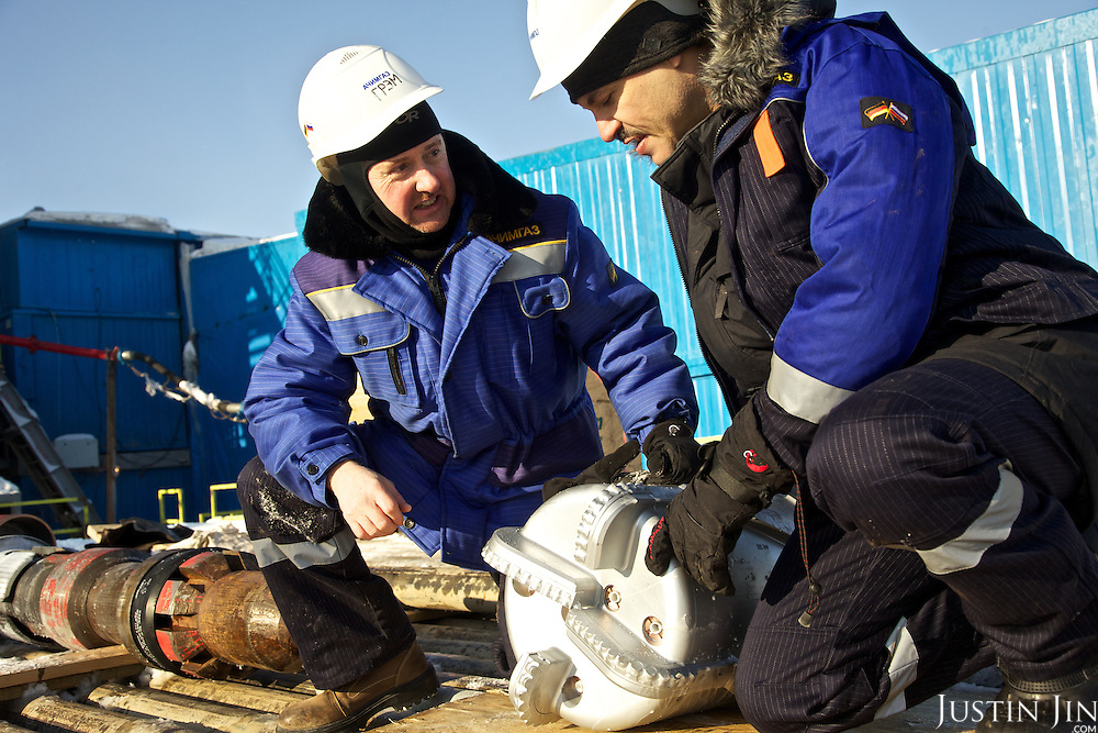 Achimgaz deputy director Ingo Neubert (R) and Graham at the gas drilling well in Novy Urengoi, Siberia, Russia.