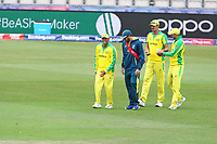 Cricket - 2019 ICC Cricket World Cup warm ups - Australia vs. Sri Lanka<br /> <br /> Usman Khawaja of Australia winces after injuring himself whilst fielding during the cricket world cup warm up match at the Hampshire Bowl Southampton England<br /> <br /> COLORSPORT/SHAUN BOGGUST