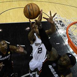 Jun 13, 2013; San Antonio, TX, USA; San Antonio Spurs small forward Kawhi Leonard (2) rebounds against Miami Heat small forward LeBron James (6) and center Chris Bosh (1) during the second half of game four of the 2013 NBA Finals at the AT&T Center. The Miami Heat defeated the San Antonio Spurs 109-93. Mandatory Credit: Derick E. Hingle-USA TODAY Sports