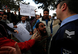 A protestor argues with police officers during a protest outside the Libyan Embassy in Attard, outside Valletta, February 22, 2011. The protest was organised by the Libyan community living in Malta against the Libyan government's crackdown on demonstrators in Libya..Photo by Darrin Zammit Lupi