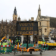 Greenpeace with their own mock fracking rig in Parliament Sqaure, Central London.  Greenpeace wants to highlight that fracking is a highly polluting and destructive way of extracting gas and to push for increased awareness of this, they set up their own rig outside Parliament without prior permission.