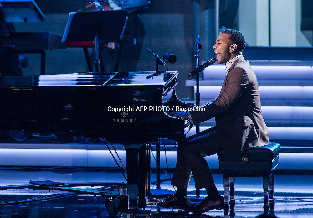 John Legend performs at a concert, Stevie Wonder: Songs In The Key Of Life - An All-Star GRAMMY Salute, at Nokia Theatre L.A. Live on February 10, 2015 in Los Angeles, California. AFP PHOTO / Ringo Chiu