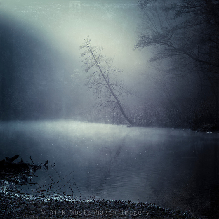 River Wupper on a cold and misty morning in Winter with the sun coming through the hills. Texturized photograph