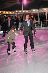 PEREGRINE ARMSTRONG-JONES and his son ROBERT ARMSTRONG-JONES  skating at a Winter Party given by Tiffany & Co. Europe to launch the 10th season of Somerset House's Ice Skating Rink at Somerset House, The  Strand, London on 16th November 2009.