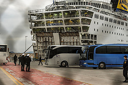 Buses wait to transfer passengers who are not infected by the COVID-19, from the Greek ferry El Venizelos to hotels in Athens to pursue the quarantine, on April 3, 2020, in the port of Piraeus near Athens. - The Greek cruise ship was placed in quarantine near Athens with 383 people on board after about 119 passengers tested positive for COVID-19, police said on March 31.<br /> <br /> Pictured: <br /> Dimitris Lampropoulos  | EEm date
