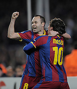 Lionel Messi of Barcelona celebrates with Andreas Iniesta after scoring his sides opening goal during the UEFA Champions League round of 16 second leg match between Barcelona and Arsenal on March 8, 2011 in Barcelona, Spain.