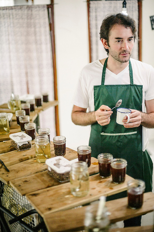 Antoine Netien, director of Coutume, has a cupping session with members of the Klassic Bean Cooperative.