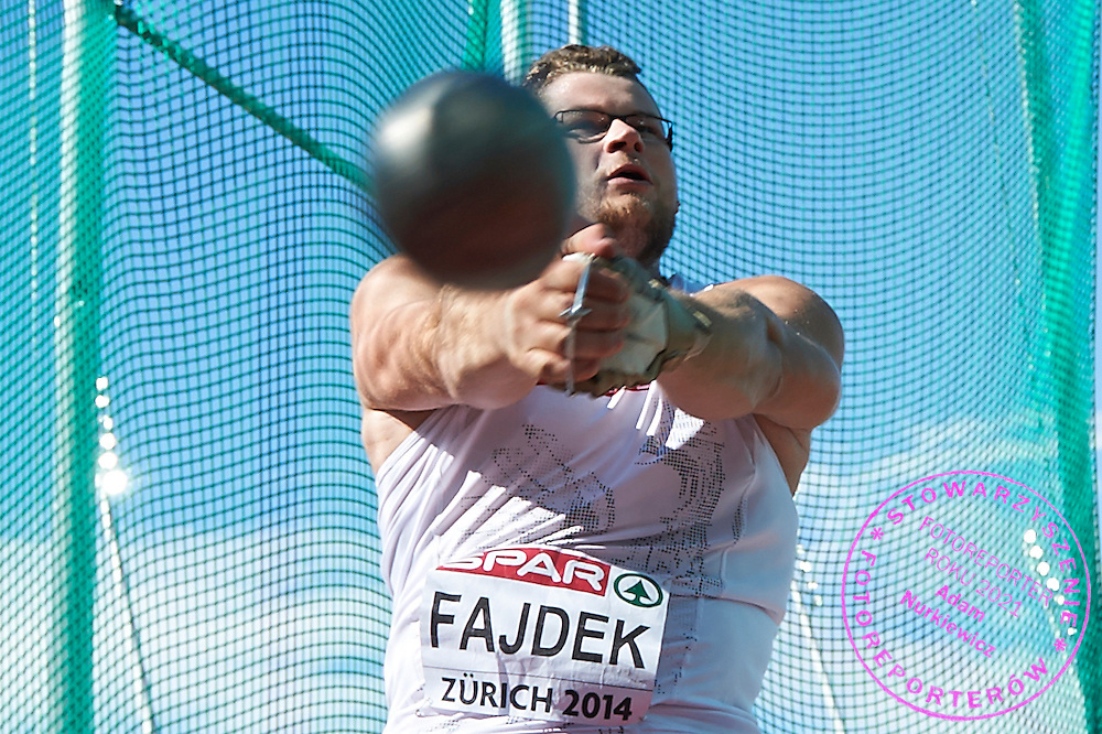 Pawel Fajdek of Poland competes in men's hammer throw final during the Fifth Day of the European Athletics Championships Zurich 2014 at Letzigrund Stadium in Zurich, Switzerland.<br /> <br /> Switzerland, Zurich, August 16, 2014<br /> <br /> Picture also available in RAW (NEF) or TIFF format on special request.<br /> <br /> For editorial use only. Any commercial or promotional use requires permission.<br /> <br /> Photo by &copy; Adam Nurkiewicz / Mediasport