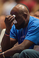 Adrian Taylor (blue) wipes away tears during a memorial service for his son Christian Taylor at Cornerstone Baptist Church in Arlington, Texas on August 12, 2015. (Cooper Neill for The New York Times)