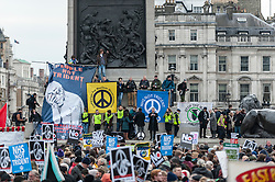 © Licensed to London News Pictures. 27/02/2016. London, UK. Thousands of people gather in Trafalgar Square for a rally to protest against the renewal of the Trident nuclear missile programme.  Union officials, faith leaders, anti-nuclear activists and anti-war campaigners showed their support and listened to speakers such as Scottish First Minister Nicola Sturgeon and Plaid Cymru leader Leanne Wood on stage. Photo credit : Stephen Chung/LNP