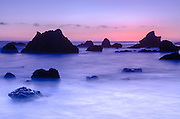 Sea stacks at dusk, El Matador State Beach, Malibu, California USA