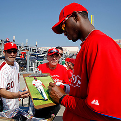 February 24, 2011; Clearwater, FL, USA; Philadelphia Phillies right fielder Domonic Brown (9) signs autographs for fans prior to a spring training exhibition game against  Florida State University at Bright House Networks Field. Mandatory Credit: Derick E. Hingle