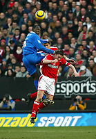 Fotball<br /> England 2004/22005<br /> Foto: SBI/Digitalsport<br /> NORWAY ONLY<br /> <br /> Charlton Athletic v Birmingham City<br /> Barclays Premiership. 15/01/2005<br /> <br /> Emile Heskey of Birmingham goes up for this aerial ball with Matt Holland and Luke Young of Charlton