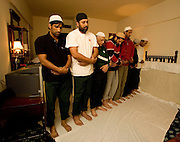 Opening batsman Salman Butt (second from far end) joins in prayers in the team's prayer room before the second test match between Pakistan and England in Faisalabad. Left is Mohammad Yousuf next to captain Inzamam-ul-Haq. Photo © Graham Morris (Tel: +44(0)20 8969 4192 Email: sales@cricketpix.com)