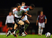 Photo: Daniel Hambury.<br />West Ham United v Liverpool. The Barclays Premiership. 26/04/2006.<br />West Ham's Hayden Mulliuns and Liverpool's Luis Garcia tussle before both are sent off.