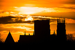 © Licensed to London News Pictures. 05/03/2019. York UK. The sun rises this morning behind York Minster on what is expected to be a rainy day in Yorkshire. Photo credit: Andrew McCaren/LNP