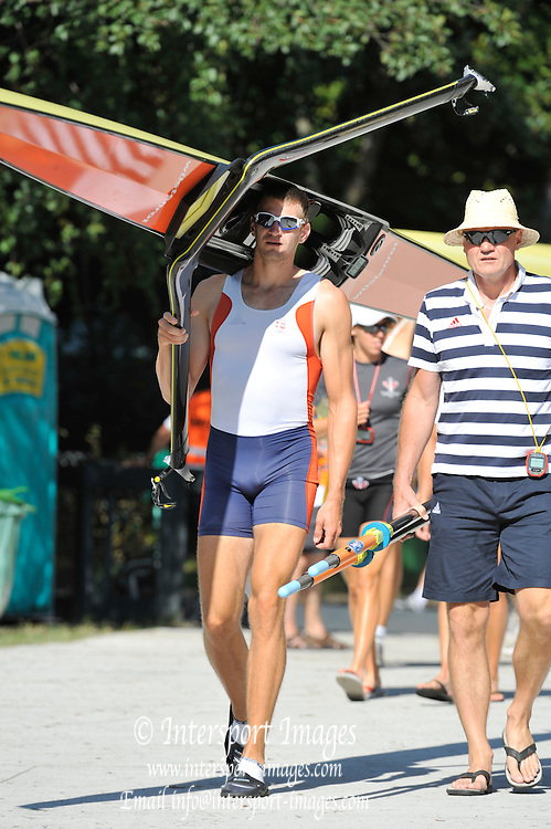 Bled, SLOVENIA.  CZE M1X. Ond?ej SYNEK and Coach Boat/Athletes Area. 2011 FISA World Rowing Championships, Lake Bled. Local Time 10:12:24   Friday  26/08/2011  [Mandatory Credit;  Intersport Images]  Original Camera File No.   2011010319.jpg