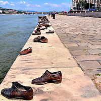 Bronze Shoes Memorial on Danube Promenade in Budapest, Hungary<br /> From October through December, 1944, The Arrow Cross Party killed 38,000 Hungarians and sent 80,000 into slave labor or death camps. When 200 Jews resisted in January of 1945, they were handcuffed in twos, led to the Danube River, told to remove their shoes and then were shot and floated away. The 60 pairs of bronze shoes on the Danube Promenade are a Holocaust Memorial to that event in Budapest. They were sculpted by Gyula Pauer in 2005.