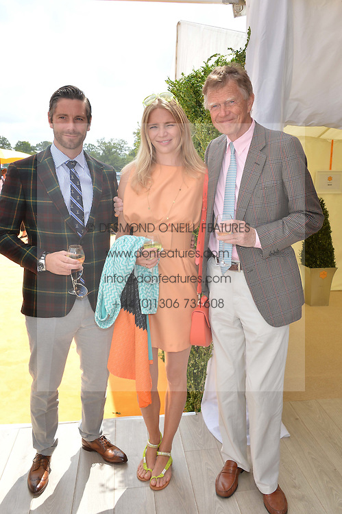 Left to right, DAVID BLAKELEY, JODIE KIDD and her father JOHNNY KIDD at the Veuve Clicquot Gold Cup Final at Cowdray Park Polo Club, Midhurst, West Sussex on 20th July 2014.