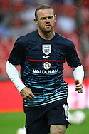 Picture by John Rainford/Focus Images Ltd +44 7506 538356<br /> 14/08/2013<br /> Wayne Rooney of England warms up before the International Friendly match at Wembley Stadium, London.